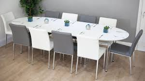 modern glass dining table quilted top white oval extending dining table quilted faux leather chairs