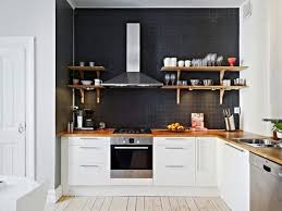 kitchen no backsplash black wall no backsplash open timber shelves against rangehood