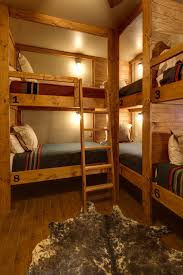 Cabin Style Homes by This Rustic Lodge Style Bunk Room Boasts A Slew Of Built In Bunk