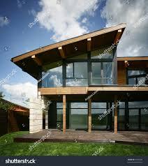 Stylish House by Stylish Design House Big Glass Windows Stock Photo 69765406