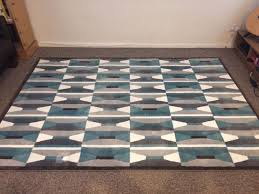 large blue white and grey patterned ikea area rug for living room