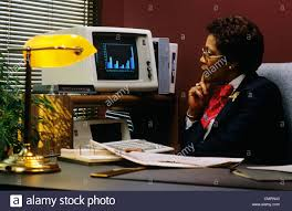 Female Executive Office Furniture 1980 1980s Black Female Executive Desk Studying Bar Graph On Pc