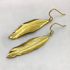 gold feather earrings gold feather earrings thief