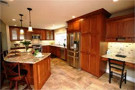 oak cabinets with dark wood floors