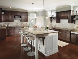 modern dark wood kitchen cabinets with contrasting white island a