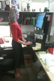 using a sit stand desk sit stand desk wikipedia