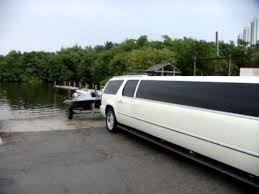cadillac escalade towing tow vehicle cadillac escalade limo at boat launch with