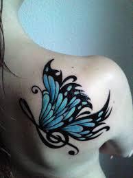 a big blue butterfly on a s back shoulder