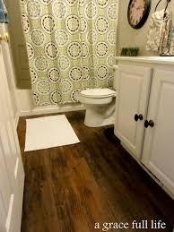 Best  Vinyl Wood Flooring Ideas On Pinterest Rustic Hardwood - Hardwood flooring in bathroom
