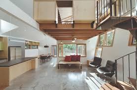zen spaces cozy nest like mezzanine studio floats above this living space