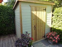 backyard garden with corner shed placement of garden shed