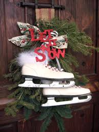 exotic outdoor christmas decorating ideas with white ice skates on