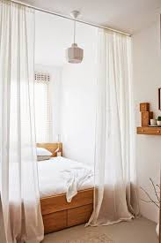Ways To Divide A Room by 25 Ways To Use Curtains As Space Dividers Digsdigs
