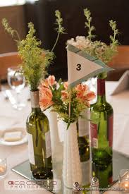 Vintage Vases Wedding Peach Flowers And Greenery In Milk Glass Vases And Wine Bottle For