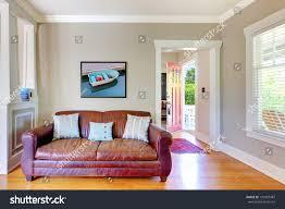 leather sofa living room open door stock photo 120987487