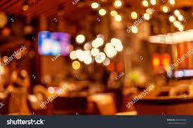 interior small restaurant blurred background blurred stock photo