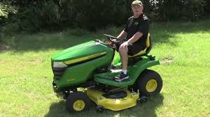 john deere x300 series how to raise and lower the deck youtube