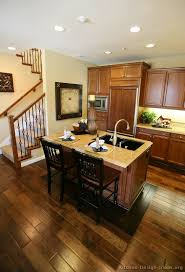 brown kitchen cabinets with wood floors wood floors