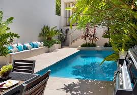 small pool house ideas charming blue and white colored pillows placed on concrete sofa