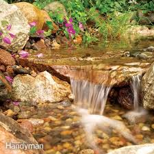 How To Make A Lazy River In Your Backyard Build A Backyard Waterfall And Stream Family Handyman
