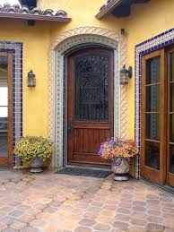 Spanish Colonial Furniture by Colorful Tiled Spanish Revival Courtyard Entry In Malibu
