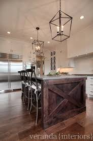 white kitchen island with granite top white cabinets stained island granite top iron lanterns