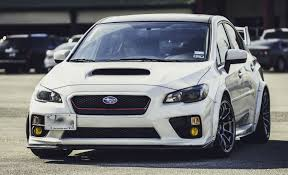 white subaru black rims added fender flares and extra wide wheels on the 2015 subaru subaru