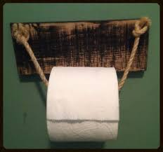 a rustic diy and barn wood towel holder for the bathroom