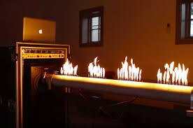 Fireplace With Music by With Music He Manipulates Sand Liquids Electricity And Fire