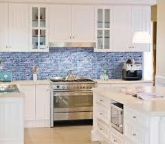 blue glass mosaic tile backsplash with simple white cabinet and