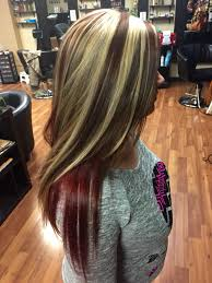 brunette hairstyle with lots of hilights for over 50 chunky blonde highlights with red brown base and bright red violet