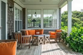 breakfast nook furniture porch beach with orange seat cushions
