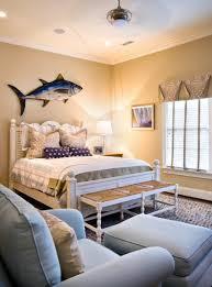large decorative fish hanging on cream wall behind white bed frame large decorative fish hanging on cream wall behind white bed frame in beach style bedroom