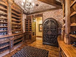 mediterranean wine cellar with crown molding exposed beam built