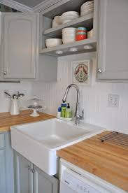 best 25 beadboard backsplash ideas on pinterest farmhouse white beadboard backsplash with my light grey cabinets and my farmhouse sink can t