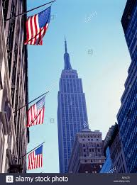 New York Flag Empire State Building And American Flag New York Usa Stock Photo