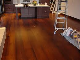 wide plank dark wood flooring for kitchen after remodel with dark
