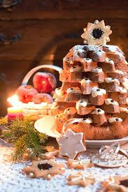 christmas tree pandoro with candle light stock photography image