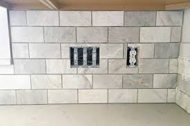 How To Tile A Kitchen Backsplash How To Install A Marble Subway Tile Backsplash Just A Girl And