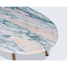 pink marble coffee table with brass legs by modern times pink