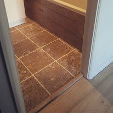 Travertine Tile Effect Laminate Flooring Scandic Oak Flooring Used For Bath Panel With Travertine Tiles In