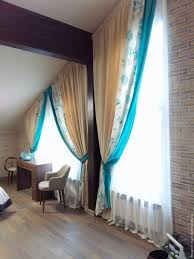 buy blinds for sloping windows with turquoise edging dark turquoise