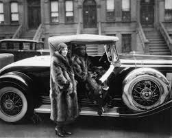 a harlem couple in raccoon coats with their cadillac new york 1932