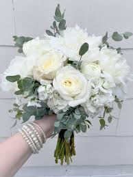 white bouquet white bridesmaid s bouquet composed of peonies stock