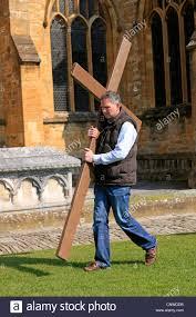 christian man holding cross easter stock photos u0026 christian man