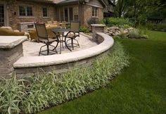 Backyard Brick Patio Design With Grill Station Seating Wall And by Paver Patios With Lighting Raised Patio Seat Wall Landscape
