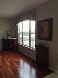 multicolored wood floors light gray walls