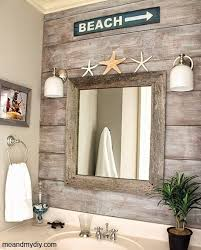 wood paneling accent wall idea for a beach bathroom http www