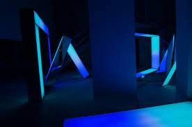 this neon light installation is like an interactive stonehenge