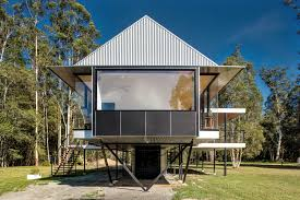 self sufficient flood proof home floats over australian bushland
